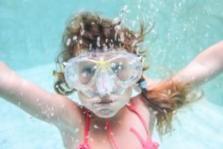 bigstock-child-girl-swimming-underwater-74742829