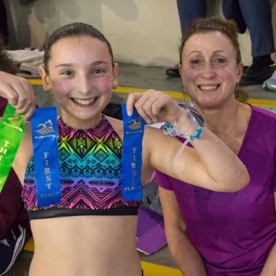 Swim school student Sienna Williams shows off her ribbons.
