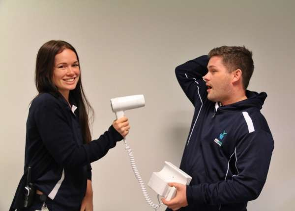 BLOWN AWAY: Duty Supervisor Claire and Operations Officer Tim trying out one of the new hairdryers.
