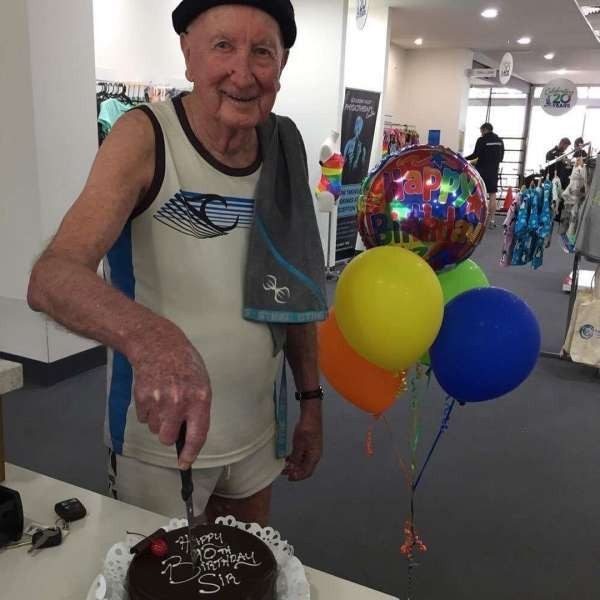 90 year old Aquamoves Member Kevin Holden cuts his Birthday Cake.