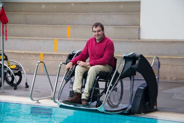 Council's Access and Inclusion Officer Mark Tomkins with the new Poolpod at Aquamoves.